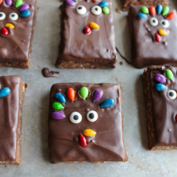 turkey decorated rice krispie treats with sunflower seed tail feathers, beak and gobbler.