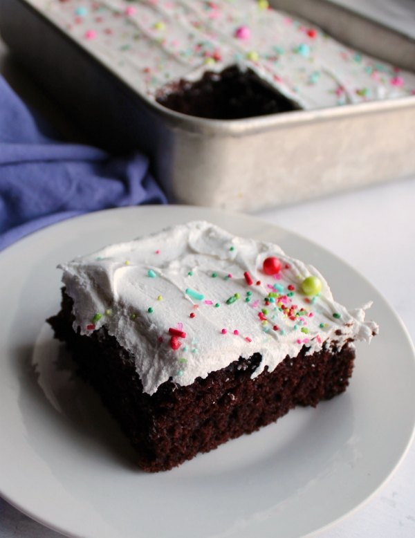 piece of chocolate cake topped with 7 minute frosting.