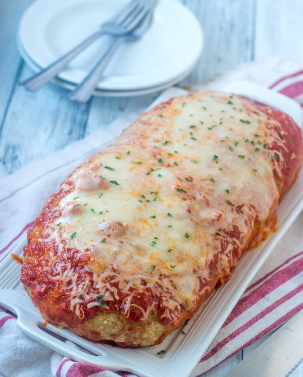 chicken parmesan meatloaf fresh from the oven with tomato sauce and melted cheese on top
