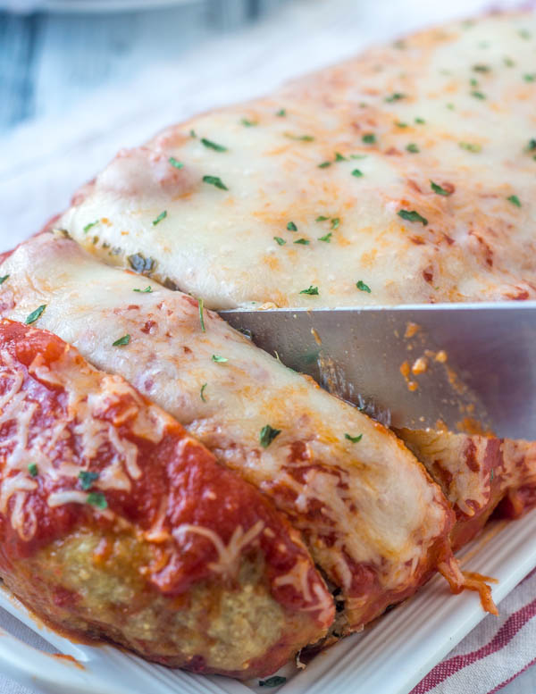 knife cutting into chicken parmesan meatloaf