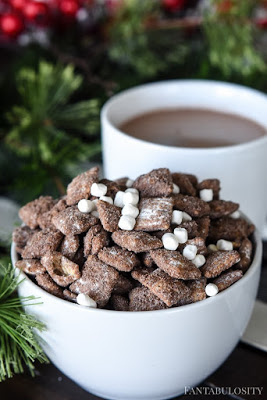 bowl of hot chocolate puppy chow next to mug of hot cocoa