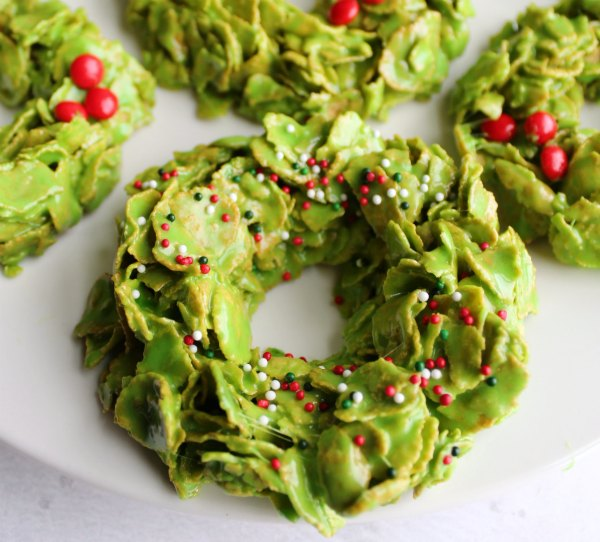 close up of corn flake wreath cookies with Christmas sprinkles and red hots
