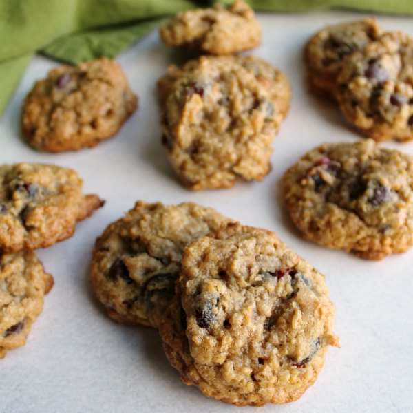 close up stacks of cranberry dark chocolate oatmeal cookies