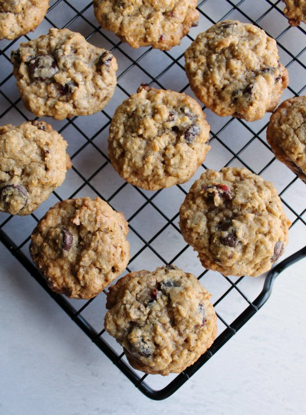looking down on wire cooking rack with cranberry dark chocolate oatmeal cookies
