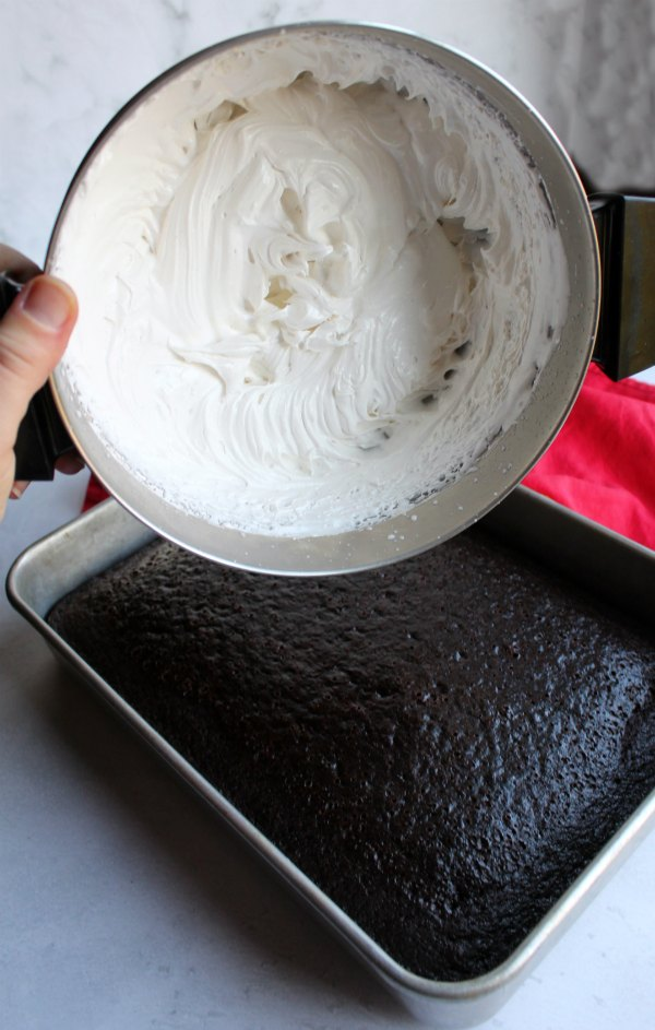 stiff white 7 minute frosting ready to be spread on cake.