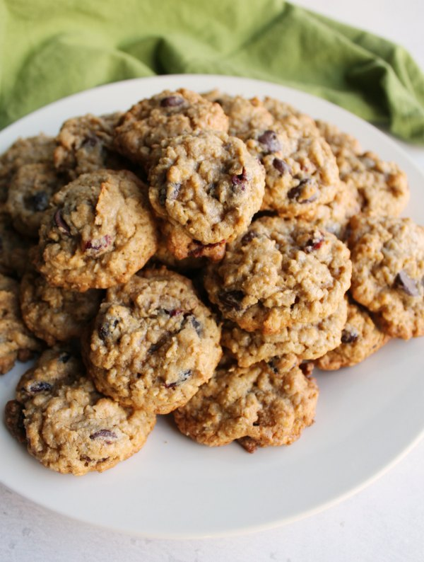 plate filled with cranberry dark chocolate oatmeal cookies