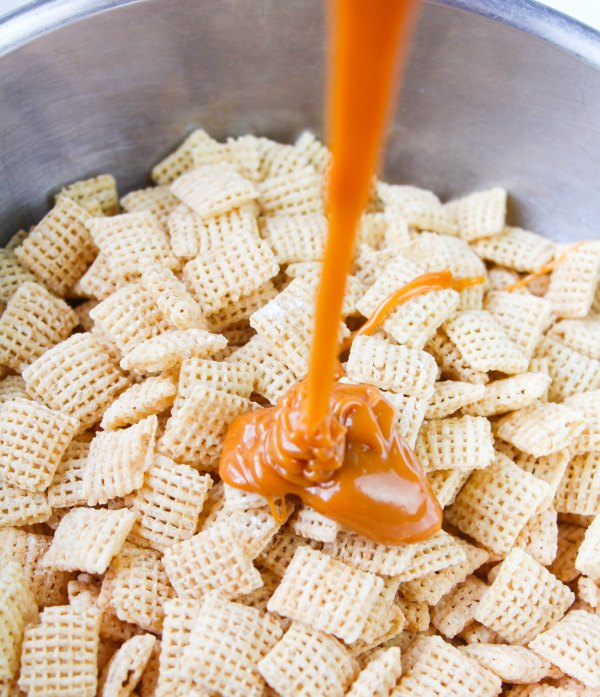 pouring melted caramel over cereal.