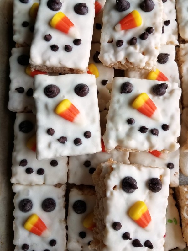 close stack of snowman decorated rice krispie treats.