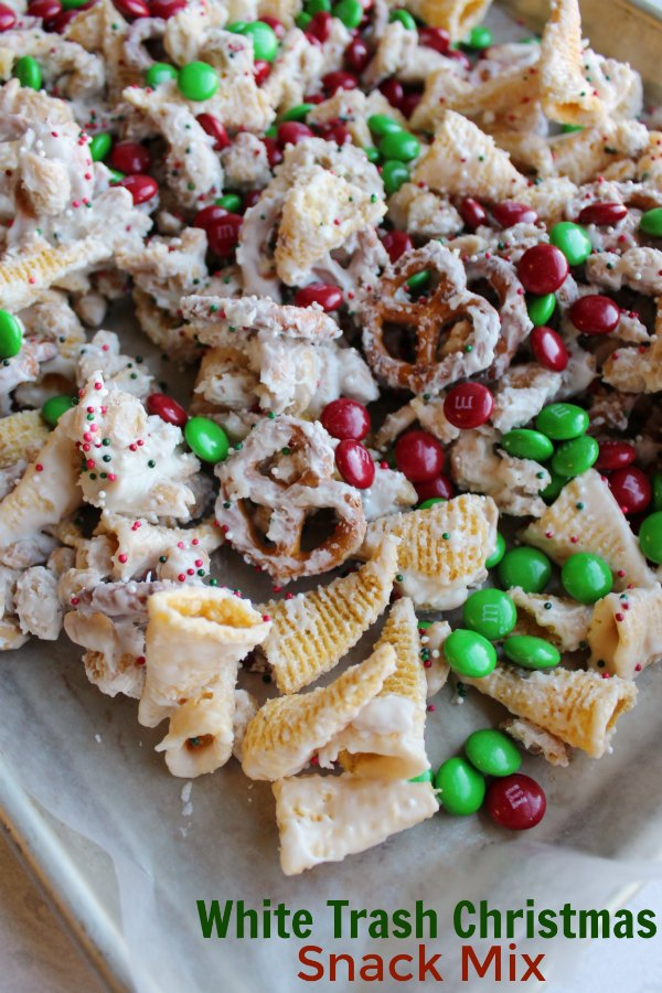 This fun sweet and salty snack mix only takes a few minutes to make and the results are delicious. This version is decked out in red and green for the merriest of white trash snack goodness, but the colors could easily be changed for any occasion.