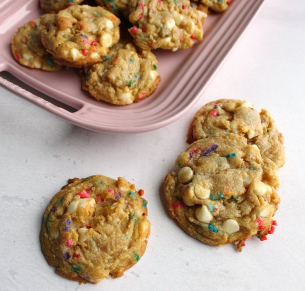funfetti white chocolate chip cookies on pink platter.