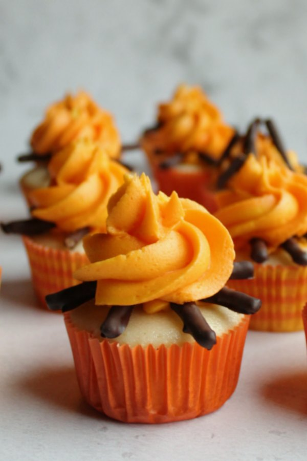 cupcakes with chocolate covered pretzel twigs and yellow and orange fire frosting
