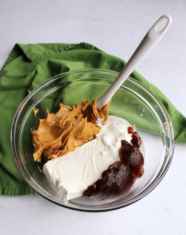 mixing bowl of peanut butter and jelly dip ingredients.