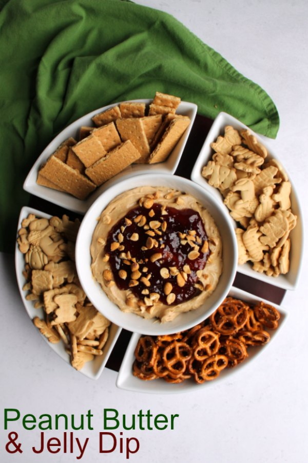 This fun peanut butter and jelly dip is loaded with the flavors of childhood. It is light and creamy, not too sweet and super fun. Make it for your next get together to see for yourself!