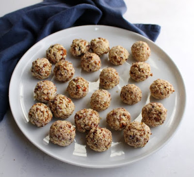 platter of individually sized cranberry cheese balls ready to serve