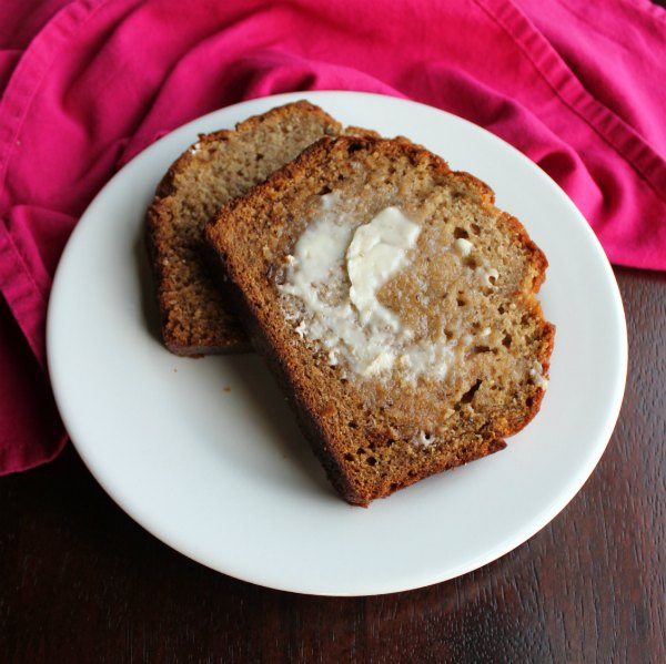 Slices of banana bread with a smear of butter on top.
