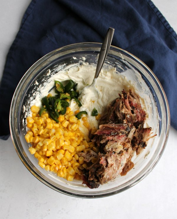 mixing bowl filled with creamy pulled pork dip ingredients.