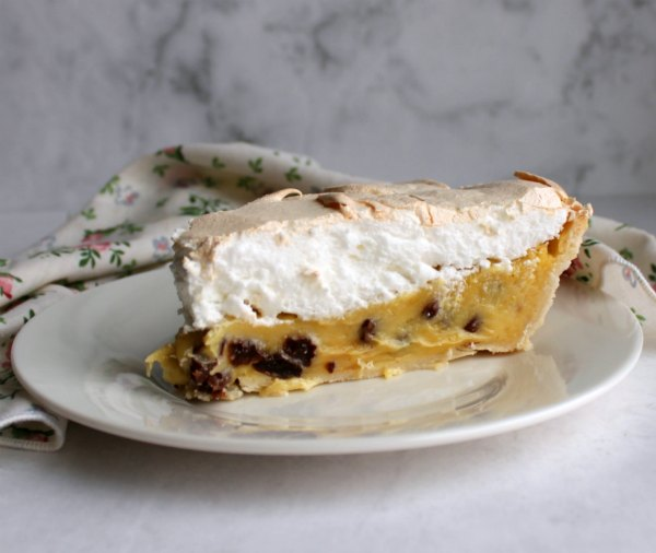 slice of meringue topped sour cream pie ready to eat.