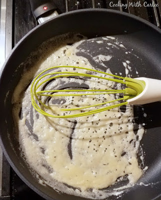 simple roux in skillet with whisk