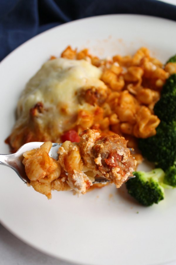 bite of baked pasta on fork ready to eat