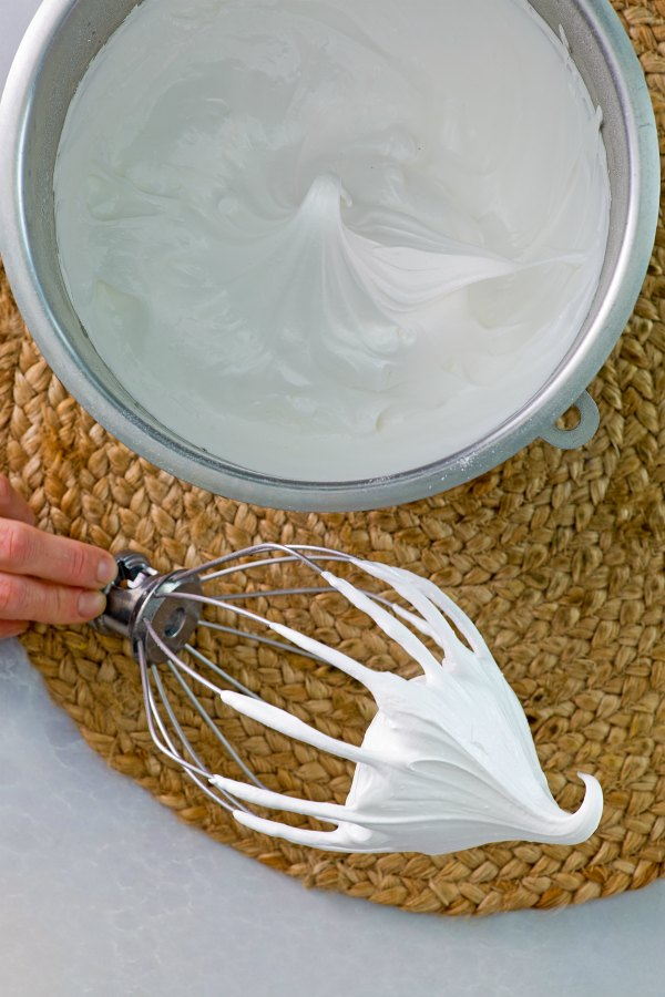 mixer bowl of egg whites whipped to stiff peak.
