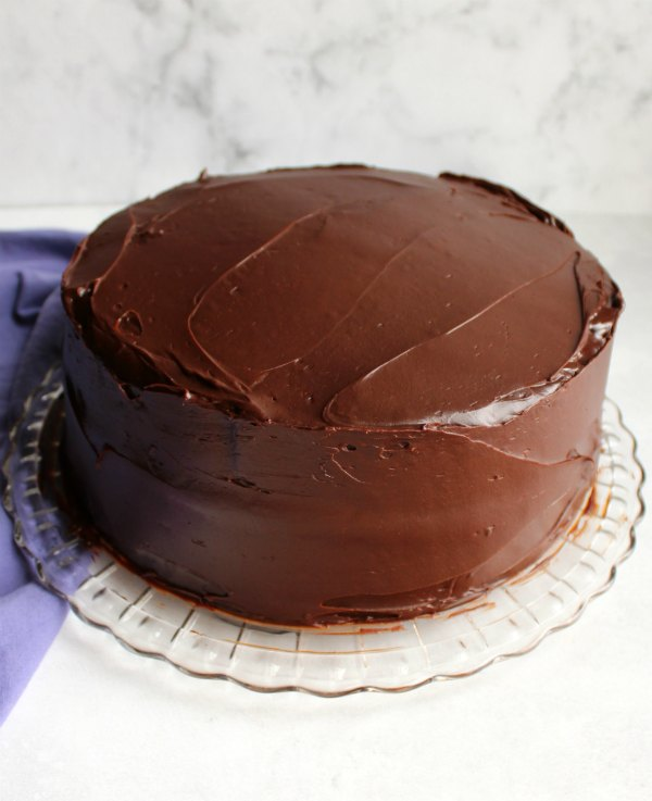 cake frosted with glossy chocolate frosting