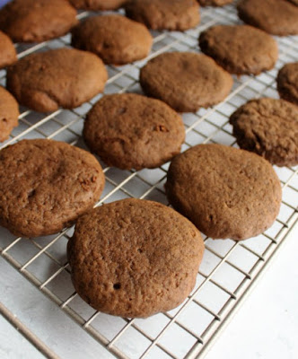 fresh baked chocolate sour cream cookies on cooling rack