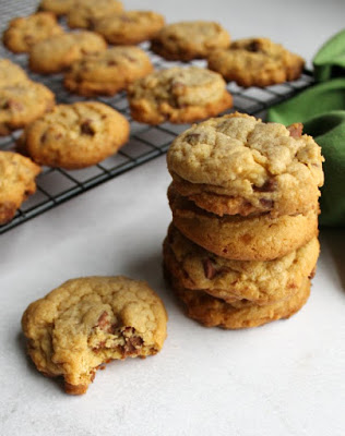 stack of pudding chocolate chip cookies with bite missing from one