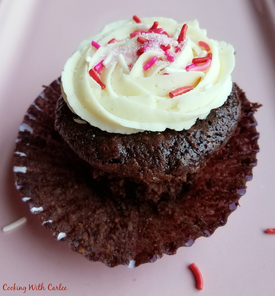 wrapper pulled down exposing moist chocolate banana cupcake.