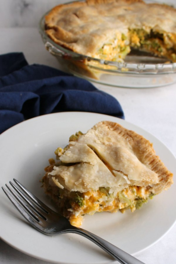 bite missing from slice of ham broccoli and cheese pot pie