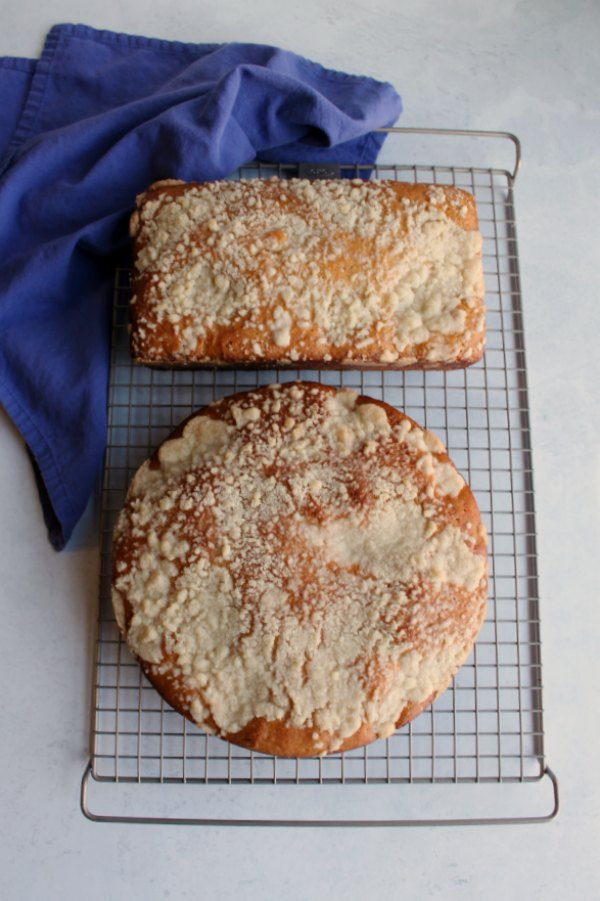 one loaf shaped cake and one round cake on cooling rack