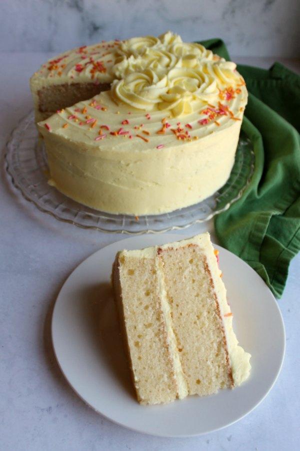 slice of lemon velvet cake lying down on dessert plate