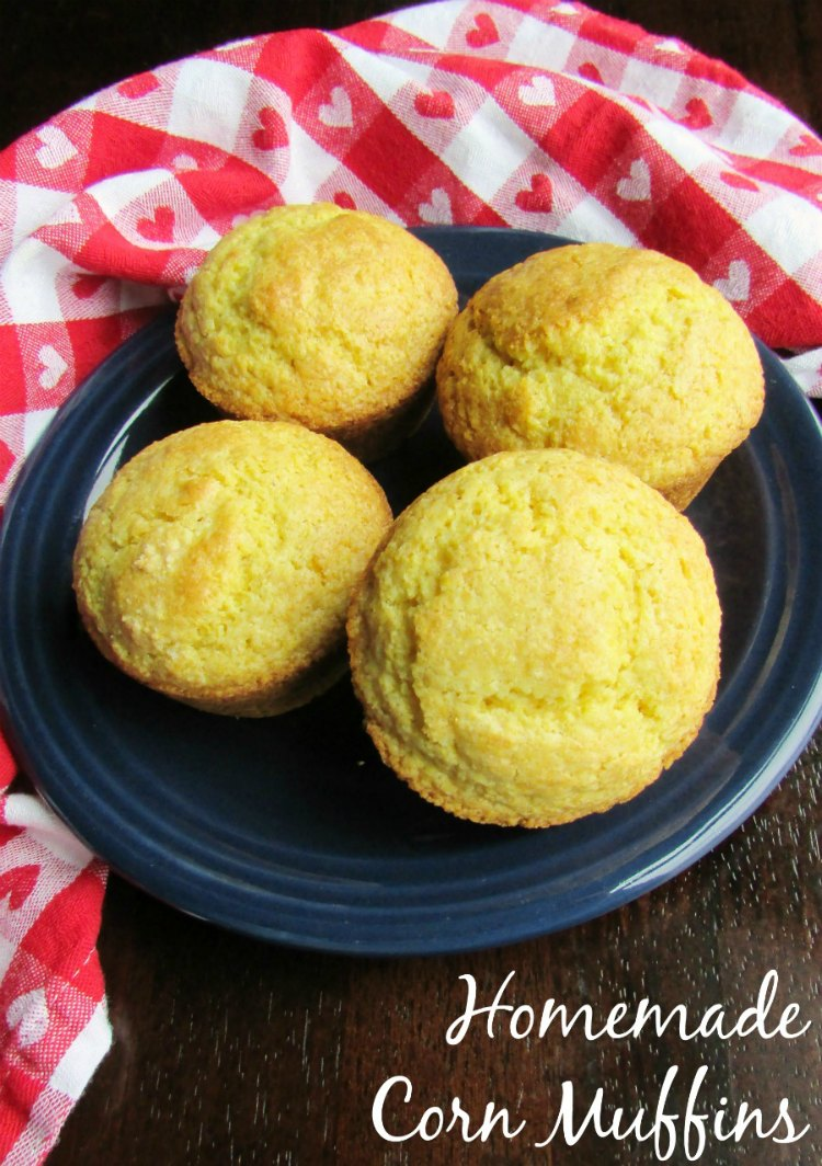 plate of corn muffins with red and white check napkin