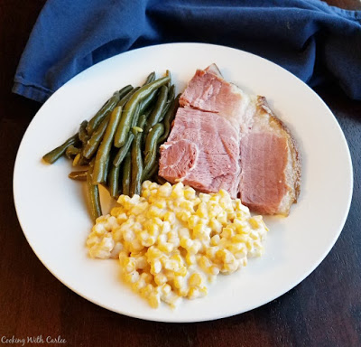 ham, green beans and creamy corn on dinner plate