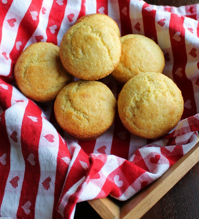 basket of golden brown corn muffins ready to eat.