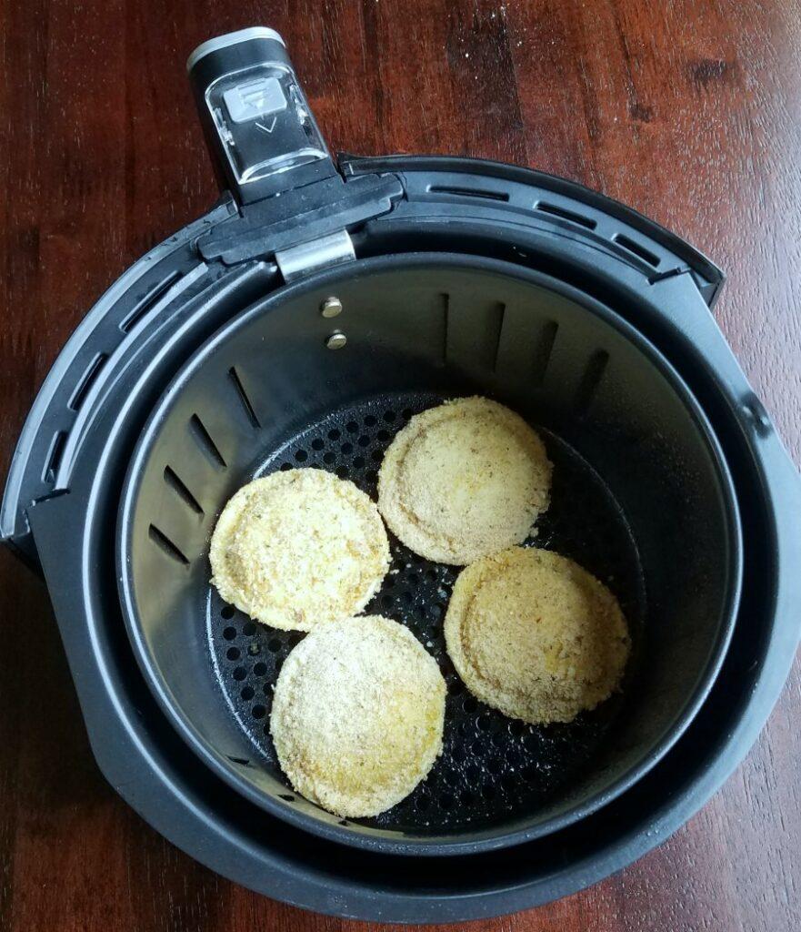 air fryer basket is bread crumb coated ravioli.