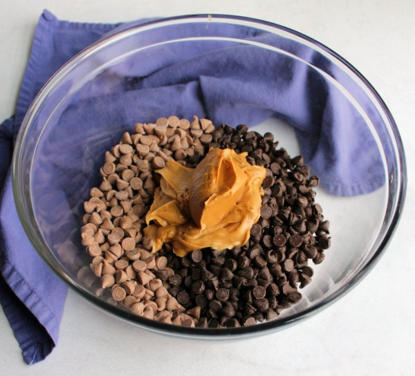 glass bowl of chocolate chips, caramel chips and peanut butter