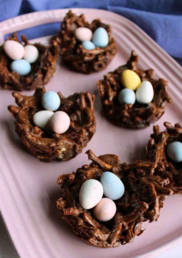 pink platter of chocolate nests with mini candy eggs