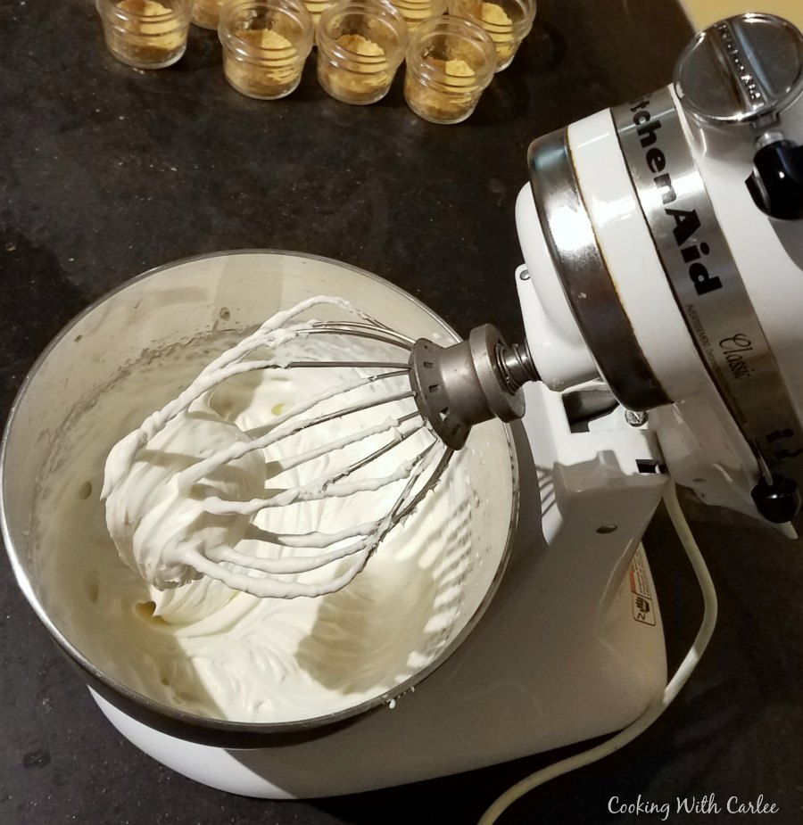 stand mixer bowl filled with fluffy no bake lemon cheesecake