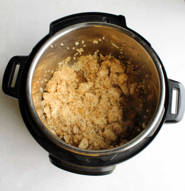 browned chicken and toasted arborio rice in instant pot ready to make risotto.