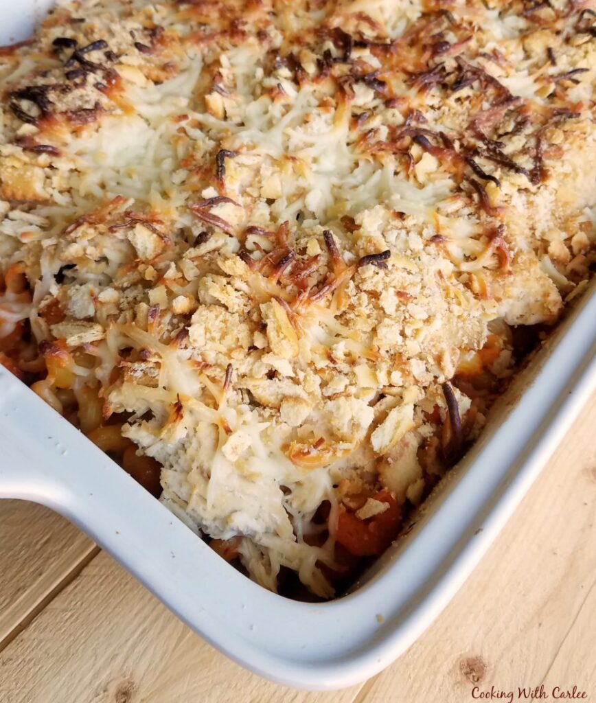 casserole dish filled with pasta, chicken and cheese.