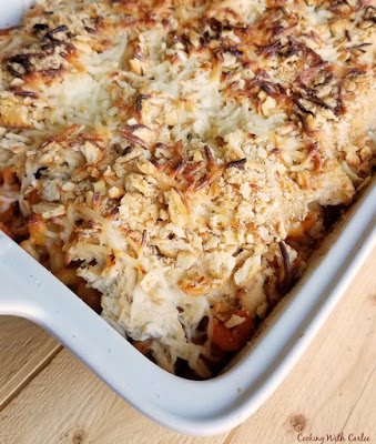 casserole dish filled with pasta, chicken and cheese
