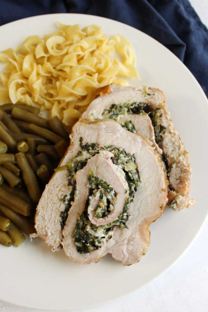 close up of slices of pork loin stuffed with spinach and cheese