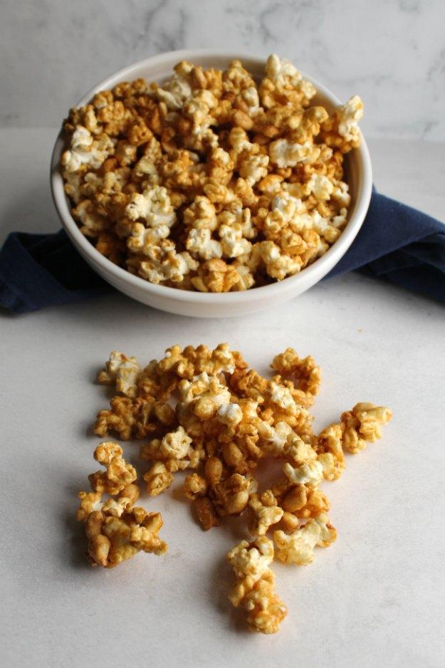 bowl of caramel corn spilling onto counter