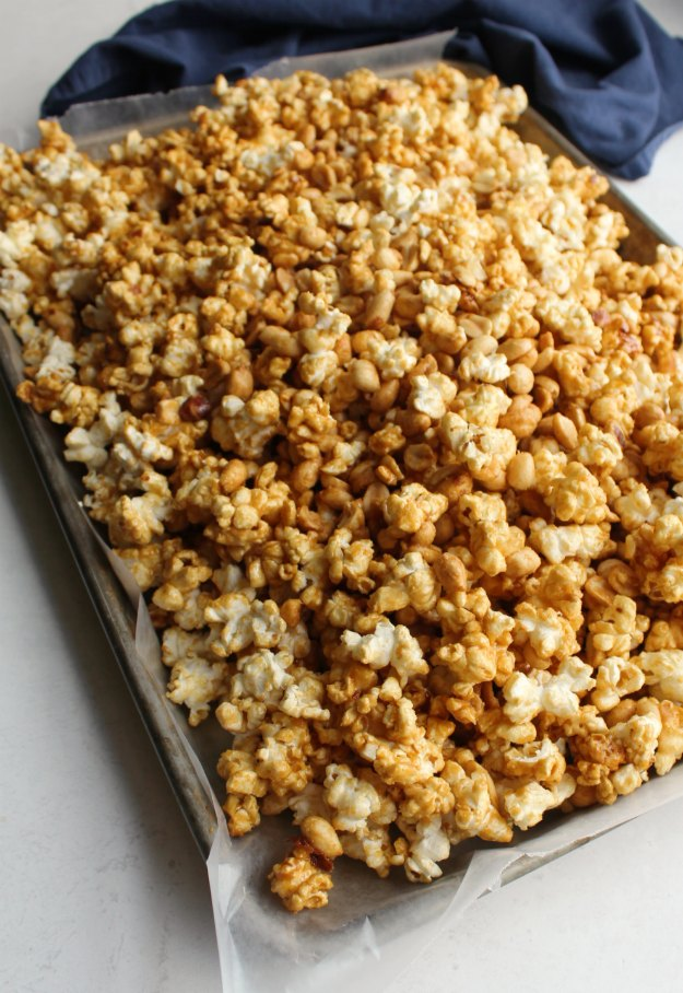 sheet pan piled high with crunchy caramel corn with peanuts, Cracker Jack style