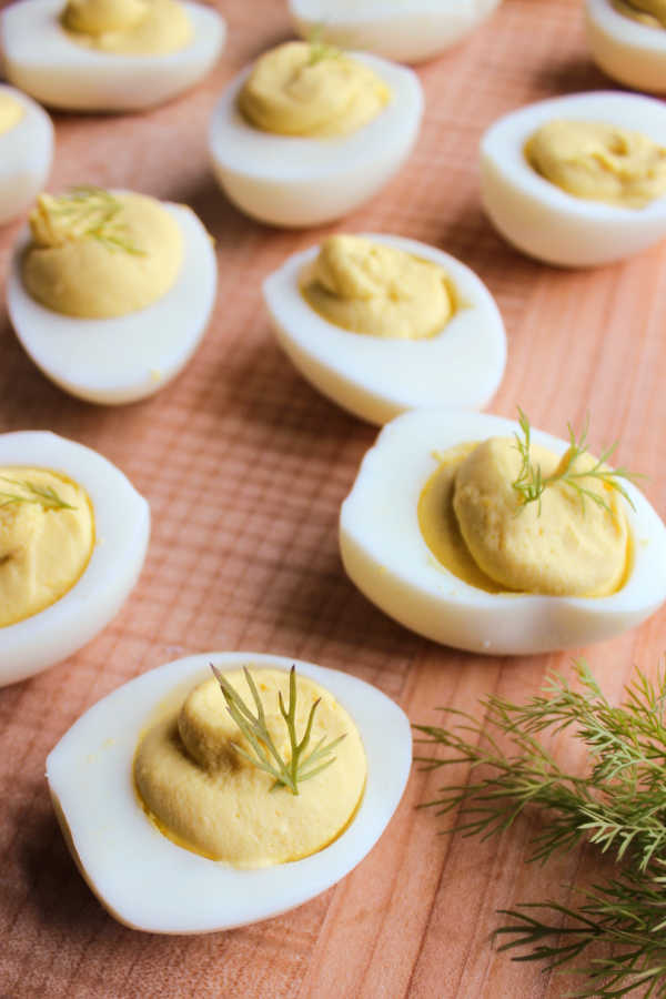 deviled eggs with sprigs of fresh dill.