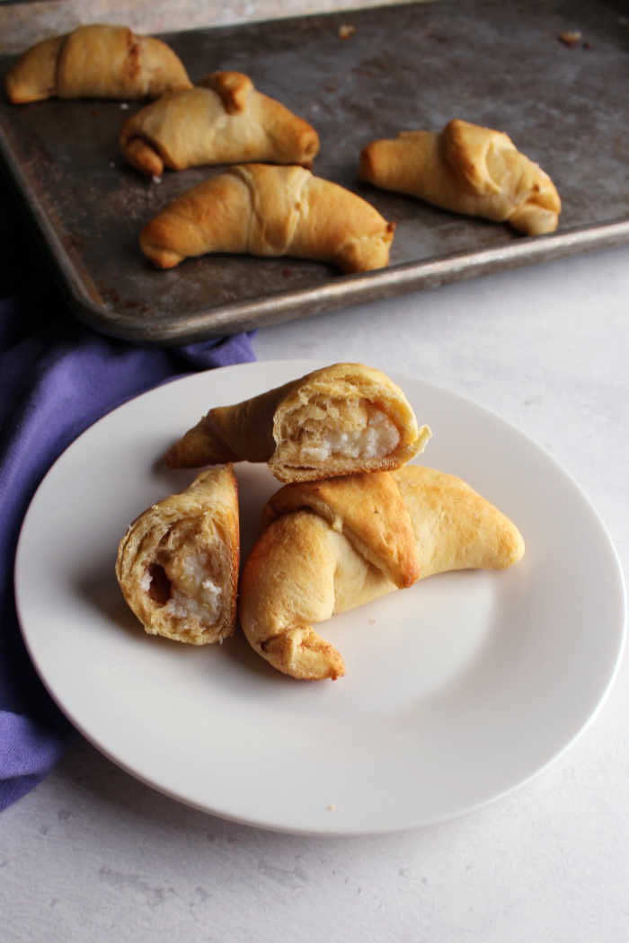 inside of sweet cream cheese stuffed crescent roll ready for breakfast