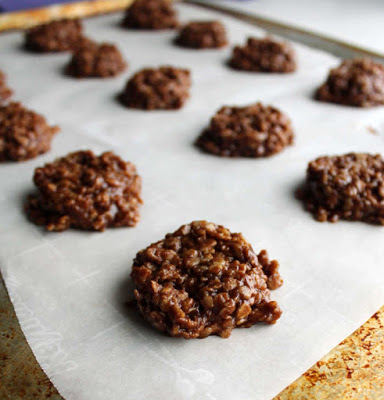scoops of chocolate peanut butter no bake cookie mixture on wax paper