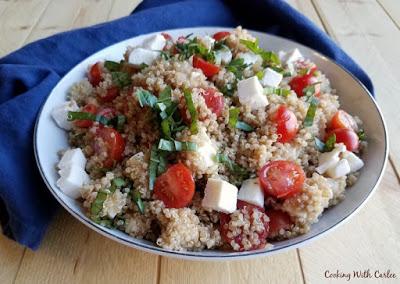 side view of bowl of caprese quinoa salad