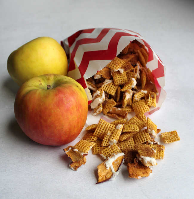 bag of apple pie snack mix next to apples
