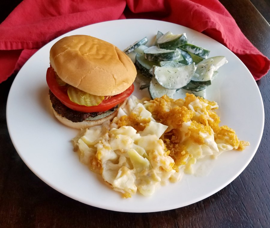 cheesy cabbage casserole with a hamburger and cucumber salad